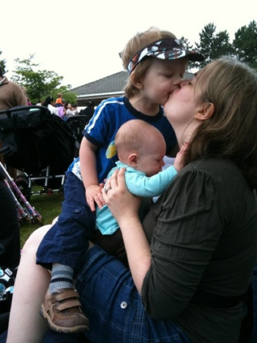 mom with toddler boy and baby girl at a park