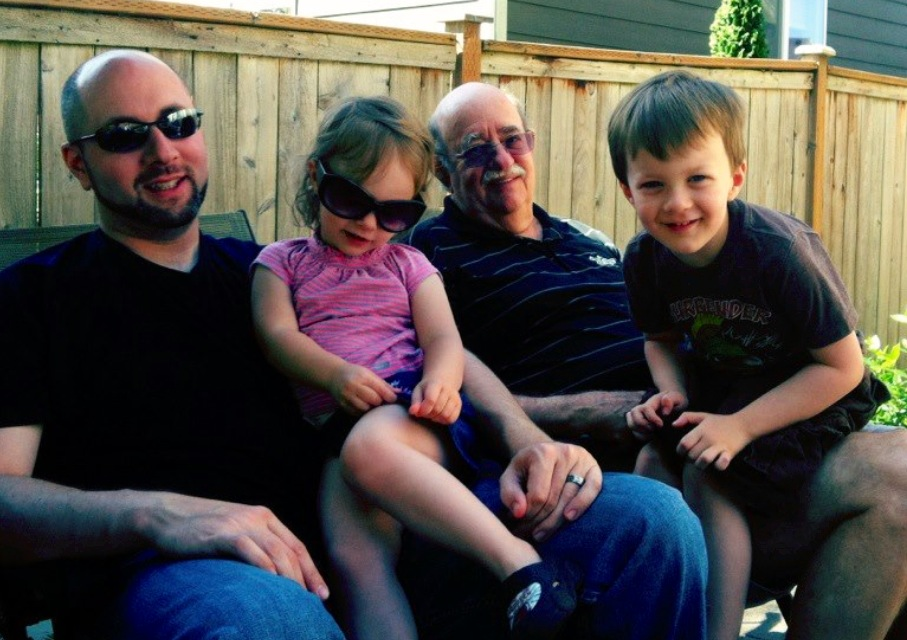 3 years later a much happier, more social kid. Seen here sitting on Grandpa's lap.