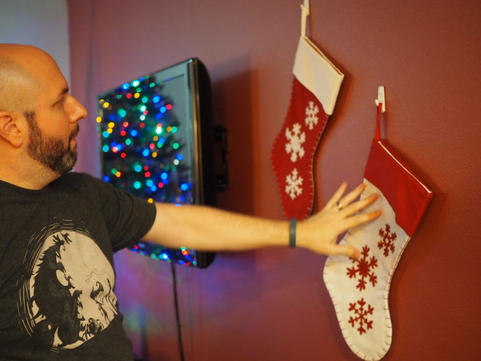 recycle old stockings as holiday wall decor