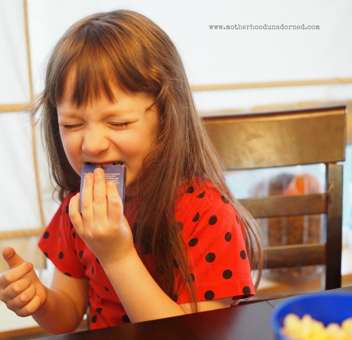 Tearing open her Skystones cards #upyourbreakfastgame #ad