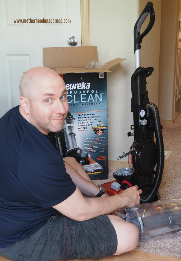 John putting together the new Eureka vacuum #CleaningUntangled #ad