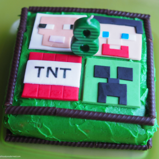 green minecraft birthday cake with fondant toppers and ovation sticks