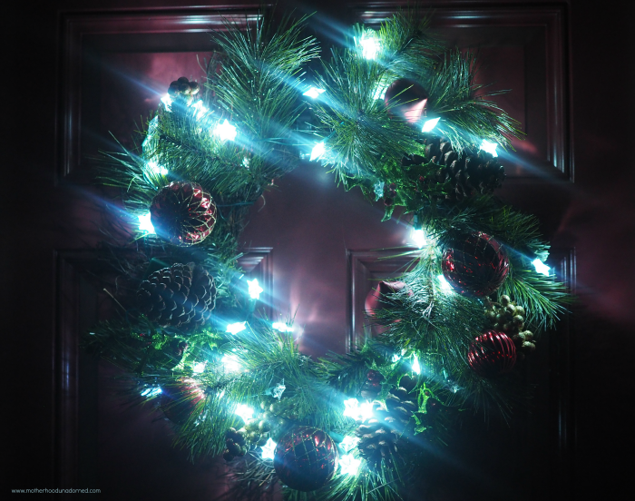 lighted wreath at night