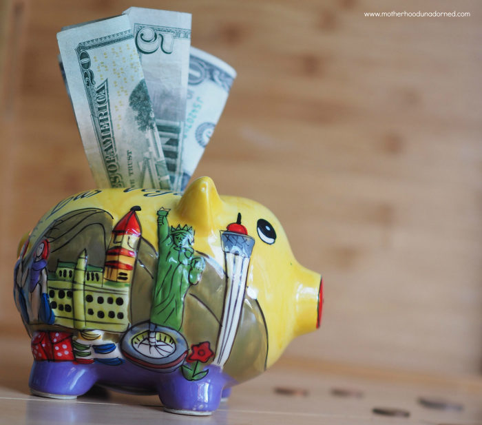piggy bank with money coming out of it
