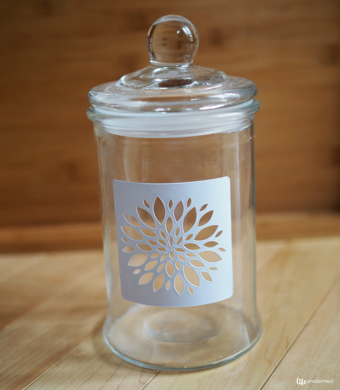 adhesive stencil on glass jar
