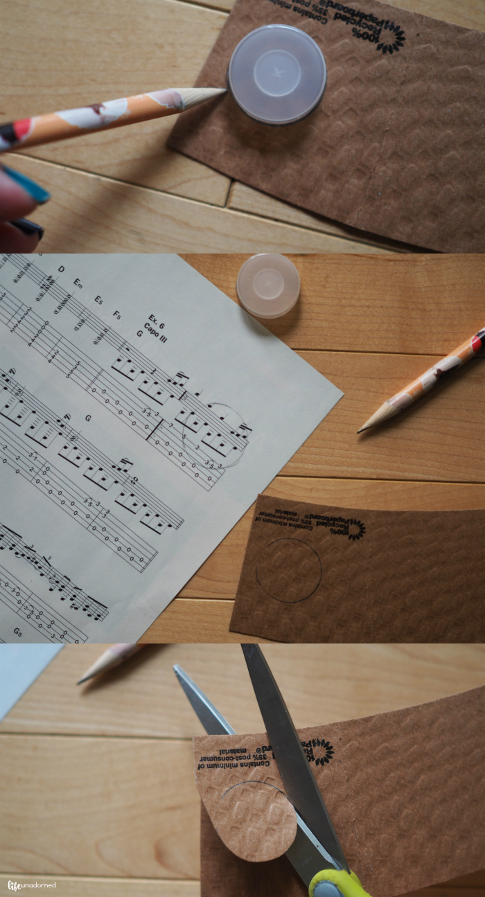 Cut out circles of sheet music and coffee sleeve