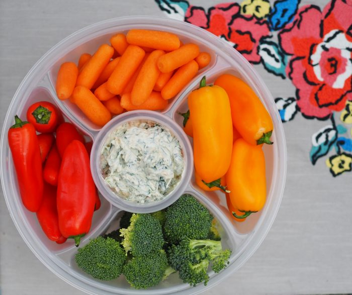 veggies and spinach dip in Snapware veggie-tainer bowl